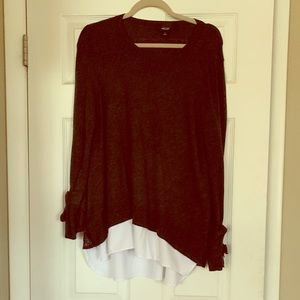 Dark gray sweater top with white hem detail